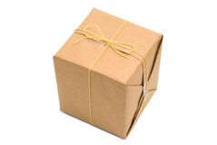 Parcel wrapped in brown paper and tied. Stock Photo