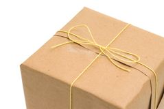 Parcel wrapped in brown paper and tied. royalty free stock images