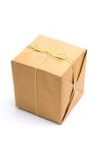 Parcel wrapped in brown paper and tied. Stock Images