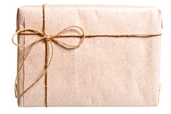Parcel wrapped in brown paper Royalty Free Stock Photos