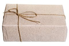 Parcel wrapped in brown paper Stock Photo