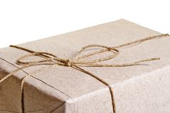 Parcel wrapped in brown paper Royalty Free Stock Photo
