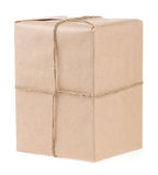 Parcel wrapped with brown paper on white Stock Images