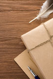Parcel wrapped with brown paper on wood Royalty Free Stock Images