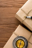 Parcel wrapped with brown paper on wood Royalty Free Stock Image