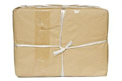 A parcel wrapped in brown paperand bl Stock Photos