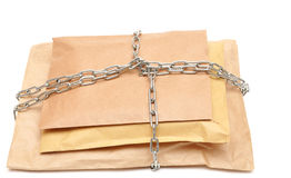 Parcel wrapped in a chain Royalty Free Stock Photos