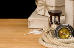 Parcel wrapped and compass on black Stock Photography