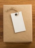 Parcel wrapped packaged box on wood stock images