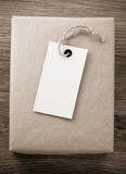 Parcel wrapped packaged box on wood Royalty Free Stock Image