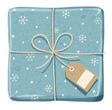 Parcel wrapped up with rough blue paper, tied up with twine. With price tag stock images