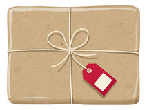 Parcel wrapped up with snowflake paper, tied up  with twine Stock Photos