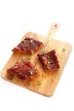 Parcelas de reforços picantes do BBQ fotografia de stock