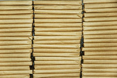 Parcels. Flat parcels wrapped in brown paper arranged in three stacks stock photography