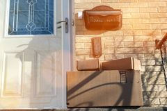 Parcels boxes Delivery Outside the Door. royalty free stock images