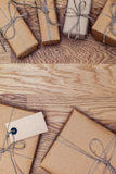 Parcels and boxes in eco paper on the wooden table. Top view. Stock Photo