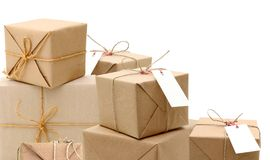 Parcels in brown wrapping paper. And blank tags or labels isolated on white background Royalty Free Stock Photos