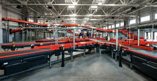 Automated sorting center. Parcels on a conveyor for sorting in the automated sorting center Stock Images