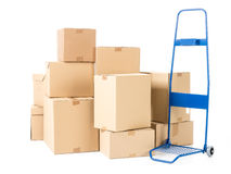 Parcels and hand truck. Hand truck and pile of cardboard boxes on white background Stock Images