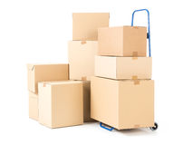 Parcels and hand truck. Hand truck and pile of cardboard boxes on white background Stock Photography