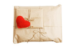 Parcels with kraft paper and red heart isolated on white Stock Photos