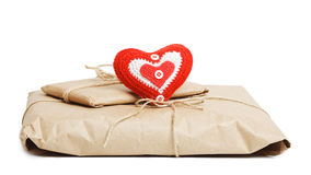 Parcels with kraft paper and red heart isolated on white Stock Photography