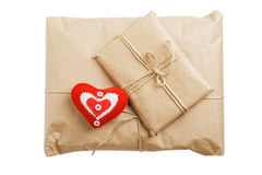 Parcels with kraft paper and red heart isolated on white Royalty Free Stock Photo