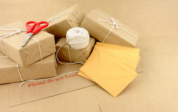 Parcels And Packaging. Group of postal packaging including parcels and envelopes Royalty Free Stock Image