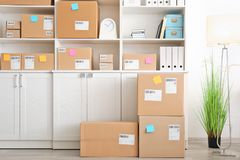 Parcels ready for shipment to customers in home office Stock Images