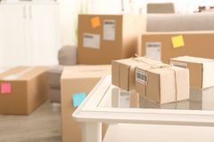 Parcels ready for shipment to customers. On table in home office. Startup business stock photography