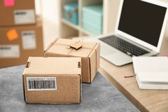 Parcels ready for shipment to customers on table Stock Photography