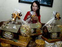 Parcels. Traders were packed parcels of pastries in the city of Solo, Central Java, Indonesia Stock Photo