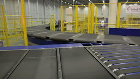 Parcels traveling on the conveyor belt stock footage