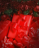 Parcels under christmas tree Stock Images