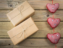 Parcels  wrapped in brown paper and string with hearts Royalty Free Stock Images