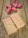Parcels wrapped in brown paper and string with red check decorat Stock Photography