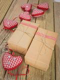 Parcels wrapped in brown paper and string with red check ribbon Royalty Free Stock Photos