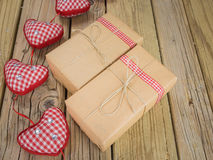 Parcels wrapped in brown paper and string with red check ribbon Stock Photo