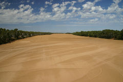 Parched riverbed. Wide angle view at parched riverbed with beautiful cloudscape. Australia Royalty Free Stock Photo