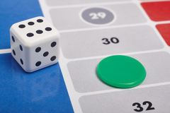Parcheesi board game detail with dice and game piece Royalty Free Stock Photography