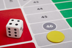 Parcheesi board game detail with dice and game piece. Horizontal royalty free stock photography