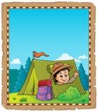 Parchemin avec le scout dans le thème 2 de tente Photo stock