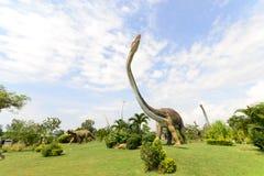 Parchi pubblici delle statue e del dinosauro immagini stock libere da diritti