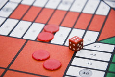 Parchis. Red chips and hit the game parchis Royalty Free Stock Photo