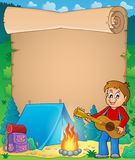 Parchment with boy guitarist in camp 1 Royalty Free Stock Photo