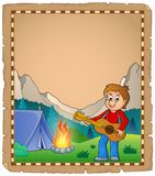 Parchment with boy guitarist in camp 2 Royalty Free Stock Images