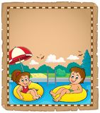 Parchment with children in swim rings Stock Photography