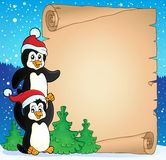 Parchment with Christmas penguins Stock Image