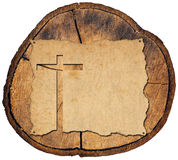 Parchment with Cross on Tree Trunk Stock Photo