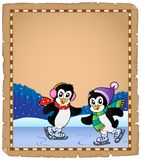 Parchment with ice skating penguins Stock Photo